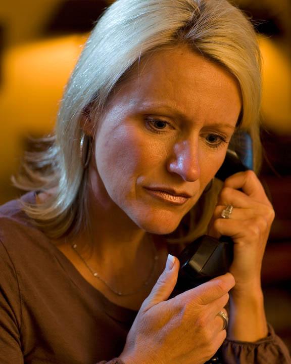 Balancing career and family is hard. Mormon Woman on phone.